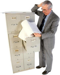 man working at file cabinet 12s.jpg